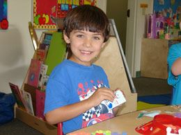 Kid at Camp Little Foot Working On Crafts