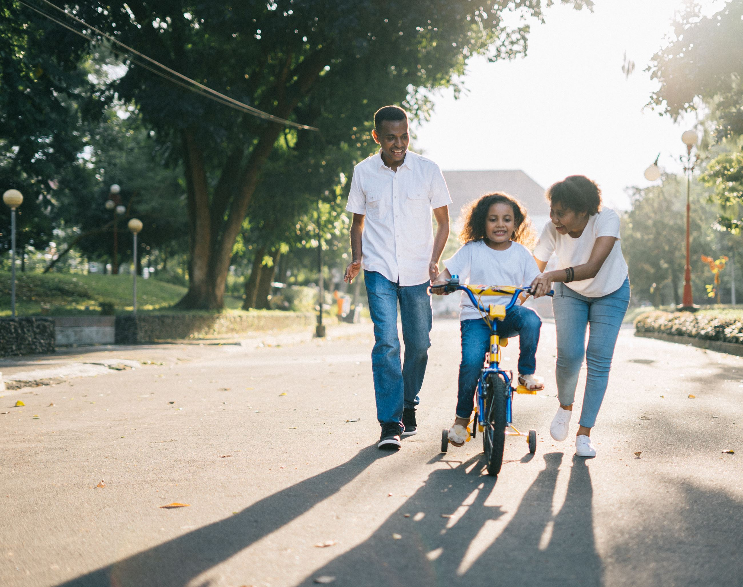family child bike riding