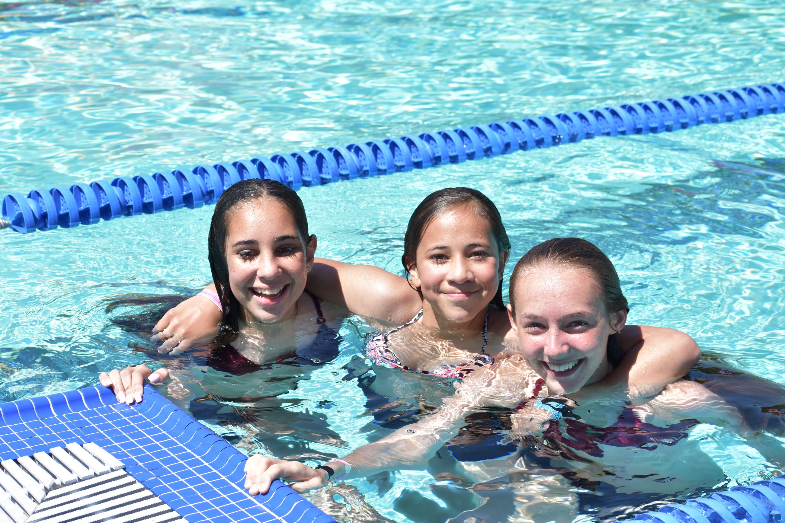 Friends cooling off in Concord Community Pool